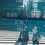 Shares falter again, but Asia poised to end October with near 4% gain
